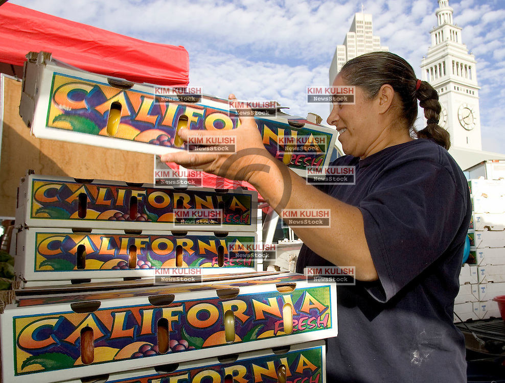 July 17, 2004--SAN FRANCISCO, CALIF.-- The historic San Francisco Ferry Building is home to specialty vendors and popular farmer's markets. Organic farmer Ginger Balakian, from Reedley, Calif, unloads produce at Saturday's Farmer's Market.  Photo by Kim Kulish/