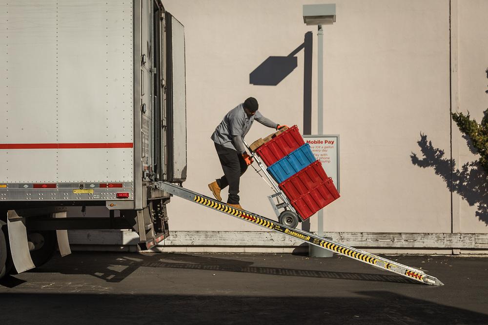 George Brisco unloads supplies in Pleasant Hill, CA.