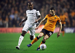 Derby County's Andre Wisdom and Wolverhampton Wanderers' Diogo Jota (right) battle for the ball during the Sky Bet Championship match at Molineux, Wolverhampton.