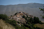 Castelluccio di Norcia seen from a nearby hill. Many collapsed houses are visible. The other structures have all been affected by the earthquake.