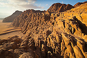 Dramatic sandstone cliffs at sunset in Wadi Rum, Jordan.