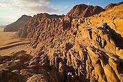 Dramatic sandstone cliffs at sunset in Wadi Rum, Jordan.