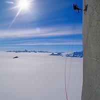 A mountaineer ascends Rakekniven Spire in Queen Maud Land, Antarctica.
