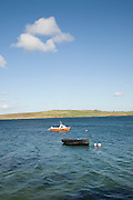 Small boats in sea in Bressay Sound, Lerwick, Shetland Islands, Scotland