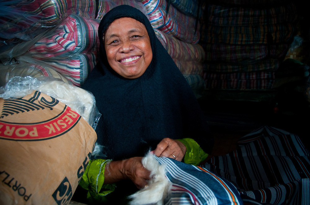 Indonesia, Java. Micro loans to poor women allow them to open small shops and businesses.