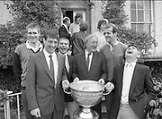 Sam Maguire Cup At Abbeyville..1986..22.09.1986..09.22.1986..22nd September 1986..Members of The Kerry,All Ireland winning team payed a courtesy call to Abbeyville, the home of Mr Charles Haughey T.D. They carried with them The Sam Maguire Cup, won at Croke Park the previous day...Whats the joke? Mick O'Dwyer pictured in deep laughter at a comment made.(L-R) Tom Spillane,Tommy Doyle,Paudie O'Se Charles Haughey and Jack O'Shea join in the fun. .Was the comment 'It's your turn to fill the cup with whiskey'?