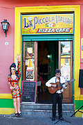 Man playing guitar outside a bar restaurant in La Boca, Buenos Aires, Federal District, Argentina.