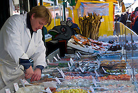 VIENNA, AUSTRIA - MARCH 8TH: Local fish vendor in the street maket,  taken March 8th 2011. This is a very popular tourist attraction in Europe.