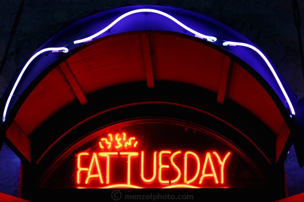 Fat Tuesday Restaurant neon sign near the River Walk along the San Antonio River in downtown San Antonio, Texas.