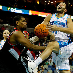 January 16, 2012; New Orleans, LA, USA; New Orleans Hornets point guard Greivis Vasquez (21) is fouled by Portland Trail Blazers center Kurt Thomas (40) during the second quarter of a game at the New Orleans Arena.   Mandatory Credit: Derick E. Hingle-US PRESSWIRE