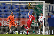 Bolton Wanderers Eóin Doyle(9) leads just over during the EFL Sky Bet League 2 match between Bolton Wanderers and Crawley Town at the University of  Bolton Stadium, Bolton, England on 2 January 2021.