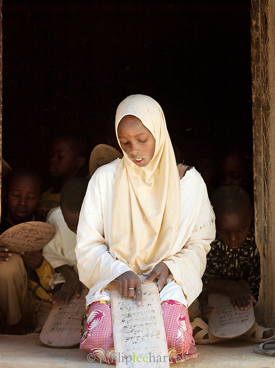 A class learning scripture from the Koran at the Koranic school in Djenné, Mali