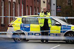 © Licensed to London News Pictures . 08/01/2020 . Bolton , UK . Police at a taped off scene on Deal Street . Police are investigating the death of a man after an ambulance attended an address on Forester Hill Avenue in Bolton and an altercation took place on nearby Deal Street . As part of their investigation GMP report having arrested four men and a woman on suspicion of manslaughter . Photo credit : Joel Goodman/LNP
