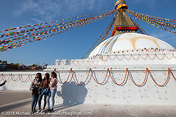 Nepalese tourists at Boudhanath Stupa in Kathmandu during our Himalayan Heroes adventure, Nepal. Saturday, November 3, 2018. Photography ©2018 Michael Lichter.