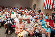 Aug, 25, 2009 -- SUN CITY, AZ: People listen to Sen John McCain during the Town Hall meeting on health care sponsored by Sen McCain at Grace Bible Church in Sun City, AZ, Tuesday. More than 1,000 people attended the meeting in the church, which seats 700. Sun City is a staunchly Republican suburb of Phoenix and most of the crowd was opposed to President Obama health care reform efforts.  Photo by Jack Kurtz