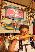 Al Franken at Minnesota Twins game, eating Minnesota corn on the cob