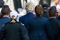 London, UK. 9th June, 2018. Police escort Geert Wilders (c), founder and leader of the Dutch Party for Freedom, to speak at the far-right March for Tommy Robinson in Parliament Street.