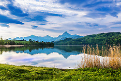 Morning reflections at Weibensee Lake in Fussen Germany