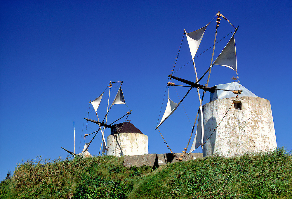 Windmills dot the countryside in the Leiria District, Portugal.