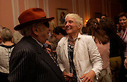 George Melly and Kate Boxer. Book launch of Take A Girl Like Me - Life With George by Diana Melly. The Polish Club. Exhibition Rd. London. 21 July 2005. ONE TIME USE ONLY - DO NOT ARCHIVE  © Copyright Photograph by Dafydd Jones 66 Stockwell Park Rd. London SW9 0DA Tel 020 7733 0108 www.dafjones.com