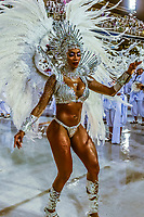 Samba dancer in the Carnaval parade of Unidos do Porto da Pedra samba school in the Sambadrome, Rio de Janeiro, Brazil.