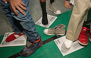 Students size their feet for new shoes during the Hilliard Fall Festival, October 24, 2013. Free shoes were distributed to all the students and parents were able to sign up for services and receive books and backpacks for their children.