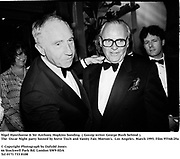 Nigel Hawthorne & Sir Anthony Hopkins bonding. ( Gossip writer George Rush behind ). at the  Oscar Night party hosted by Steve Tisch and Vanity Fair.. Morton's. Los Angeles. March 1995. 95548/29a<br />© Copyright Photograph by Dafydd Jones<br />66 Stockwell Park Rd. London SW9 0DA<br />Tel 0171 733 0108