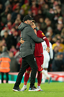 Football - 2019 / 2020 Premier League - Liverpool vs. West Ham United<br /> <br /> Liverpool manager Jürgen Klopp hugs Liverpool's Roberto Firmino at the end of the match , at Anfield.<br /> <br /> COLORSPORT/TERRY DONNELLY