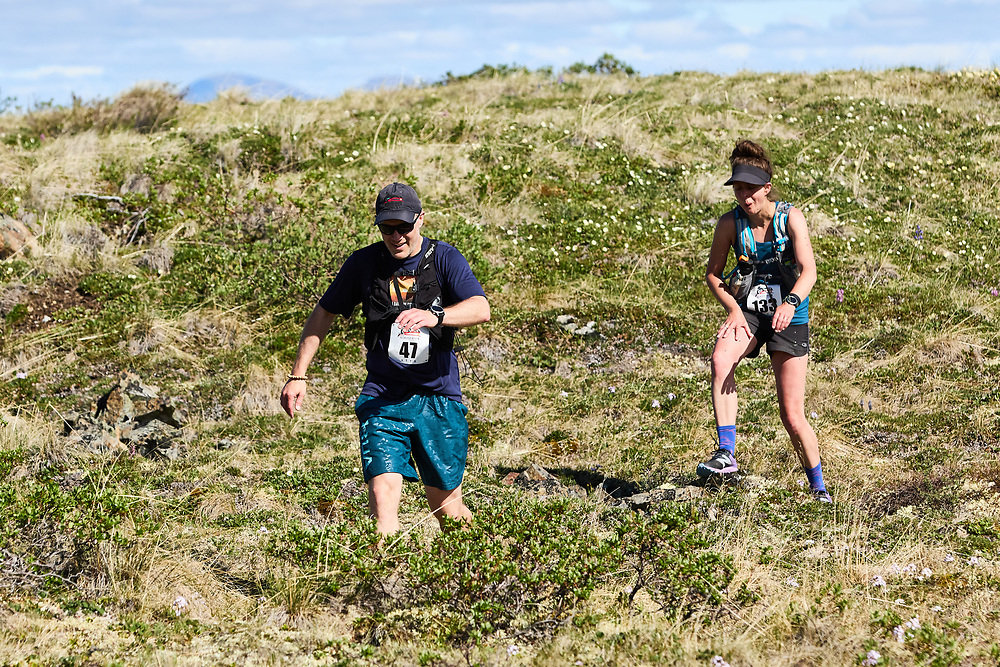 The 2021 Reckless Raven 50 Mile Ultra and Relay was run on Sunday June 27, 2021. A new aid station (AS3) was added this year, about 10 km before Jackson Lake. Given its remote location on Sumanik Ridge, horses were used to bring supplies, while water was filtered from a lake. The first male and female runners to AS3 were given a Yukon gold nugget, which they were allowed to keep if they satisfied additional race conditions.