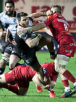 Rugby Union - 2017 / 2018 European Rugby Champions Cup: Scarlets vs. RC Toulonnaise<br /> <br /> Alby Mathewson; of Toulon tackled by Will Boyde  of Llanelli Scarlets  , at Parc y Scarlets, Llanelli.<br /> <br /> COLORSPORT/WINSTON BYNORTH