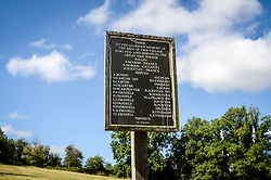 The war memorial in Imber village on Salisbury Plain, Wiltshire, where residents were evicted in 1943 to provide an exercise area for US troops preparing to invade Europe. Roads through the MoD controlled village are now open and will close again on Monday August 22.