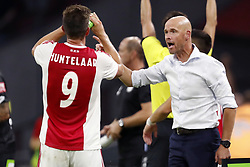 (L-R) Klaas Jan Huntelaar of Ajax, Ajax coach Erik ten Hag during the UEFA Champions League second round qualifying first leg match between Ajax Amsterdam and Sturm Graz at the Johan Cruijff Arena on July 25, 2018 in Amsterdam, The Netherlands