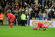 Liverpool's Iago Aspas ® shows his frustration as he punches the ground after the match ends at 2-2.  Barclays Premier league match, Swansea city v Liverpool at the Liberty Stadium in Swansea, South Wales on Monday 16th Sept 2013. pic by Andrew Orchard, Andrew Orchard sports photography,