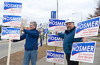 Andrew Hosmer along with long time friend Jim Bowler take a corner at Main and Court Streets in Laconia for some last minute campaign exposure Monday evening.  (Karen Bobotas/for the Laconia Daily Sun)