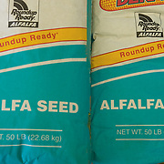 Blue sacks of Roundup Ready ® Alfalfa on Jerry Tlucek's dairy farm unable to be planted due to the moratorium
