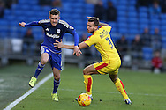 Craig Noone of Cardiff city goes past Joe Mattock of Rotherham ® . Skybet football league championship match, Cardiff city v Rotherham Utd at the Cardiff city stadium in Cardiff, South Wales on  Saturday 23rd January 2016.<br /> pic by  Andrew Orchard, Andrew Orchard sports photography.