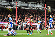 Brentford Forward Oliver Watkins (11) takes a shot on goal but misses the target during the EFL Sky Bet Championship match between Brentford and Queens Park Rangers at Griffin Park, London, England on 2 March 2019.