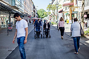 An elderly couple wearing face masks and using walking help in the shopping street in Bad Homburg. Bad Homburg is a spa city close to the Taunus mountain range.