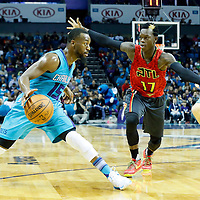 01 November 2015: Charlotte Hornets guard Kemba Walker (15) drives past Atlanta Hawks guard Dennis Schroder (17) during the Atlanta Hawks 94-92 victory over the Charlotte Hornets, at the Time Warner Cable Arena, in Charlotte, North Carolina, USA.