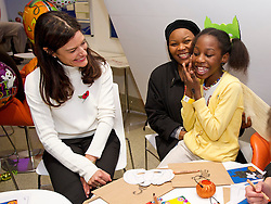 © London News Pictures. 31/10/2013 . London, UK.  MIRIAM GONZALEZ DURANTEZ talking to MONICA DIMBU (right, aged 8) while on a visit with her husband, Deputy Prime Minister NICK CLEGG, to meet children, parents and volunteers at the Great Ormond Street Hospital annual Halloween party.  Photo credit : Ben Cawthra/LNP