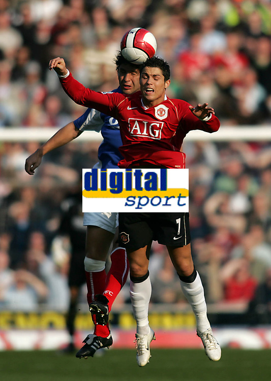 Photo: Lee Earle.<br /> Portsmouth v Manchester United. The Barclays Premiership. 07/04/2007.United's Cristiano Ronaldo (R) clashes with Dejan Stefanovic.