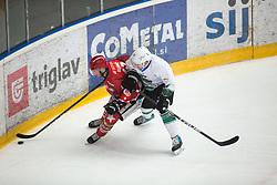 Gasper GLAVIC vs Mark CEPON during First league between HDD Acroni Jesenice vs HK SZ Olimpia, on April 23, 2019 in Jesenice, Slovenia. Photo by Peter Podobnik / Sportida