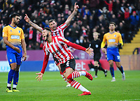 Lincoln City's Kellan Gordon celebrates scoring the opening goal<br /> <br /> Photographer Andrew Vaughan/CameraSport<br /> <br /> The EFL Sky Bet League Two - Lincoln City v Mansfield Town - Saturday 24th November 2018 - Sincil Bank - Lincoln<br /> <br /> World Copyright © 2018 CameraSport. All rights reserved. 43 Linden Ave. Countesthorpe. Leicester. England. LE8 5PG - Tel: +44 (0) 116 277 4147 - admin@camerasport.com - www.camerasport.com