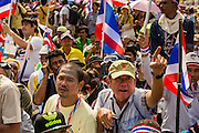 """09 DECEMBER 2013 - BANGKOK, THAILAND: Thai anti-government protestors gather in front of Government House in Bangkok. Thai Prime Minister Yingluck Shinawatra announced she would dissolve the lower house of the Parliament and call new elections in the face of ongoing anti-government protests in Bangkok. Hundreds of thousands of people flocked to Government House, the office of the Prime Minister, Monday to celebrate the collapse of the government after Yingluck made her announcement. Former Deputy Prime Minister Suthep Thaugsuban, the organizer of the protests, said the protests would continue until the """"Thaksin influence is uprooted from Thailand."""" There were no reports of violence in the protests Monday.      PHOTO BY JACK KURTZ"""