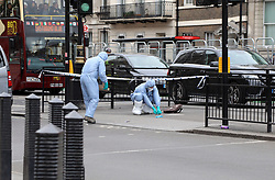 April 27, 2017 - London, United Kingdom - Forensic officers examine the scene of a suspected terrorist incident on Whitehall, in the Westminster district of central London, after a man was arrested carrying knives. (Credit Image: © Dominic Dudley/Pacific Press via ZUMA Wire)
