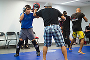 Henry Cejudo warms up backstage before his fight against Chico Camus during UFC 188 at the Mexico City Arena in Mexico City, Mexico on June 13, 2015. (Cooper Neill)