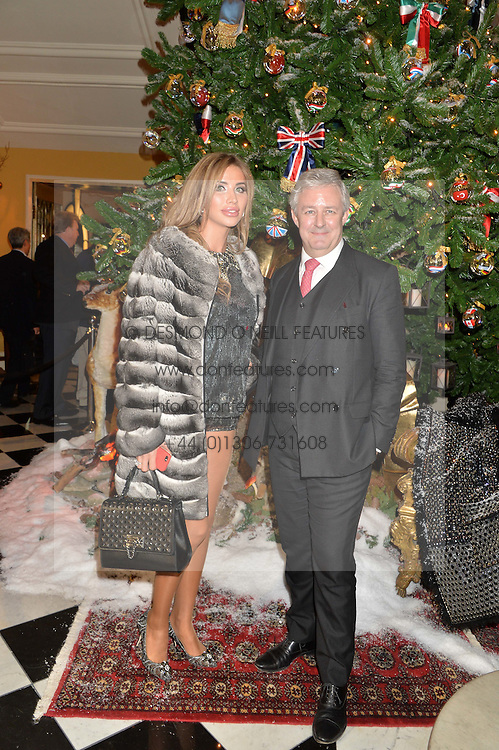 STEPHEN JOHNSON and his wife at a party to celebrate the unveiling of the 2014 Claridge's Christmas tree by Dolce & Gabbana at Claridge's, Brook Street, London on 19th November 2014.