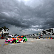 Danica Patrick returns to the garage area due to a thunderstorm during the first practice session of the 56th Annual NASCAR Coke Zero400 race at Daytona International Speedway on Thursday, July 3, 2014 in Daytona Beach, Florida. (AP Photo/Alex Menendez)