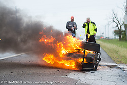 Ken Smith watches as his 1928 Harley Davidson JD burns on the side of the road at the beginning of Stage 7 of the Motorcycle Cannonball Cross-Country Endurance Run, which on this day ran from Sedalia, MO to Junction City, KS., USA. Thursday, September 11, 2014.  Photography ©2014 Michael Lichter.