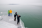 Tourists stand on the deck of a Stan Stephens cruise boat in Prince WIlliam Sound near Valdez, Alaska.